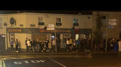 Social distancing 1; Crowds congregate outside a Kells pub